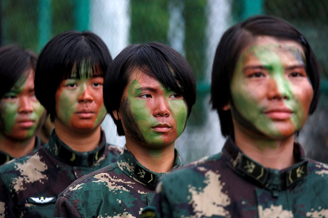 People's Liberation Army soldiers stand in line before a performance during an open day at a naval base in Hong Kong, China July 8, 2017. (Photo by Bobby Yip/Reuters)