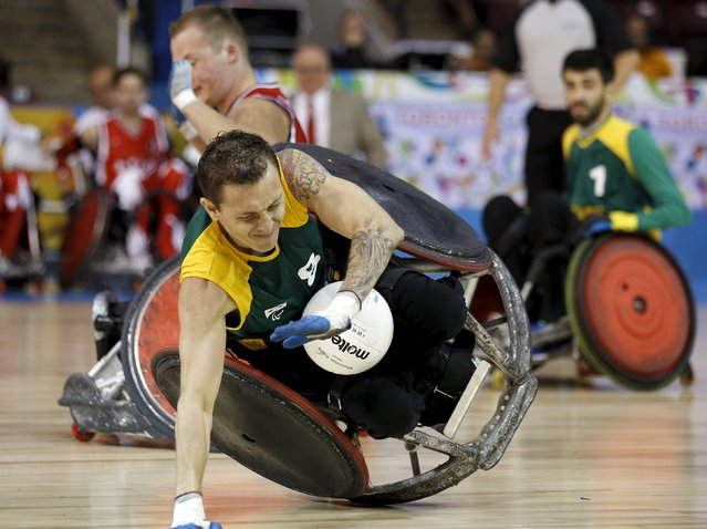 Brazil's Rafael Hoffman falls near Canada's Zak Madell during their wheelchair rugby match during the Toronto 2015 Parapan Am Games in Mississauga, Ontario August 8, 2015. (Photo by Chris Helgren/Reuters)