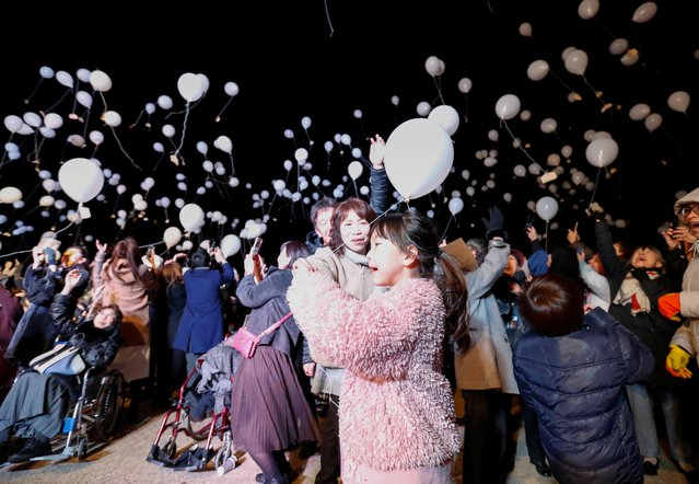 Revellers release balloons as they take part in New Year countdown event in Tokyo, Japan, January 1, 2020. (Photo by Issei Kato/Reuters)