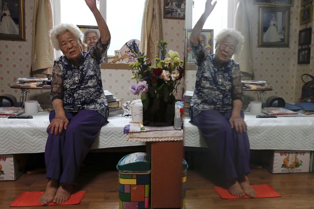 """South Korean former """"comfort woman"""" Lee Ok-sun recalls how she was taken to a Japanese military """"comfort station"""" during World War Two, in her room at the """"House of Sharing"""", a special shelter for former """"comfort women"""", in Gwangju, South Korea, July 24, 2015. (Photo by Kim Kyung-Hoon/Reuters)"""