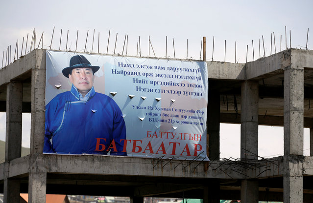 A poster of an independent candidate is pictured at a suspended construction site ahead of the parliamentary elections on the outskirts of Ulan Bator, Mongolia, June 27, 2016. (Photo by Jason Lee/Reuters)