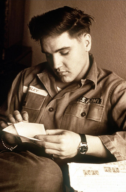 Presley in his army fatigues in this undated handout photo. Presley, born in Tupelo, Mississippi in 1935, died at his Memphis home of Graceland on 16 August 1977. (Photo by AFP Photo)