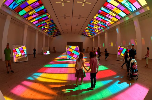 A light show by French artist Daniel Buren called Catch, which is on display at the Baltic Arts centre in Gateshead, on August 6, 2014. Sunlight hits 10 mirrors and reflects different coloured vinyl from the skylight. (Photo by Owen Humphreys/PA Wire)