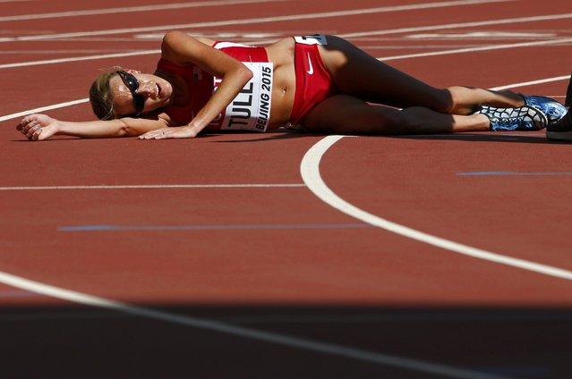 Nicole Tully of the U.S. falls after finishing the women's 5,000 metres heats during the 15th IAAF World Championships at the National Stadium in Beijing, China August 27, 2015. (Photo by David Gray/Reuters)