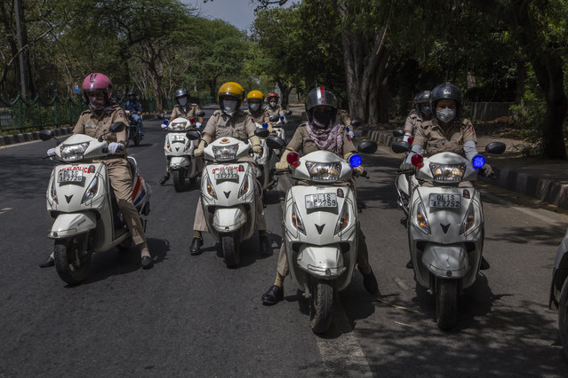 Indian police women on their mopeds patrol a deserted road, as India remains under an unprecedented lockdown over the highly contagious coronavirus (COVID-19) on April 17, 2020 in New Delhi, India. In a televised address, Indias Prime Minister Narendara Modi on Tuesday morning extended till May 3 the 21-day lockdown that was imposed in the country on March 25 to curb the spread of coronavirus which has caused 448 deaths and affected over 13,400 people. (Photo by Yawar Nazir/Getty Images)