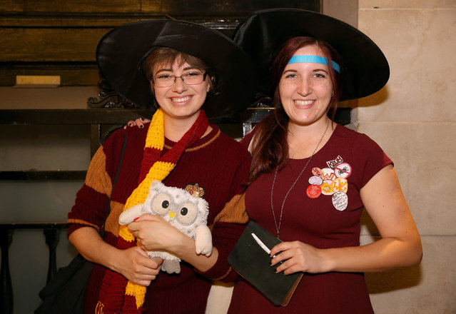 Fans in costume queue at an event to mark the release of the book of the play of Harry Potter and the Cursed Child parts One and Two at a bookstore in London, Britain July 30, 2016. (Photo by Neil Hall/Reuters)
