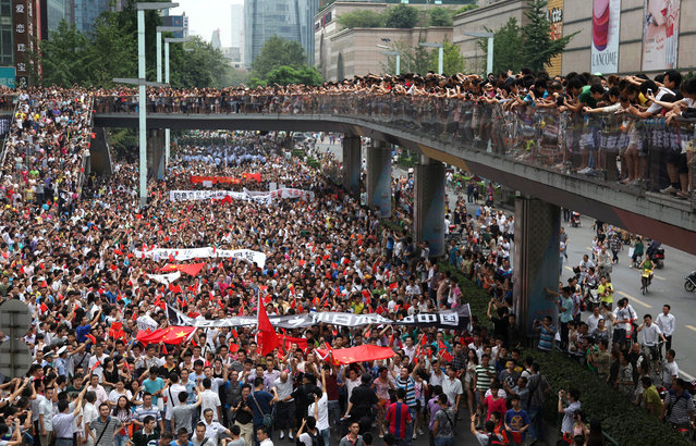 Thousands of Chinese protesters take part in a demonstration in Chengdu, Sichuan province against Japan's claim of the Diaoyu islands, as they are known in Chinese, or Senkaku islands in Japanese, on August 19, 2012. (Photo by STR/AFP)
