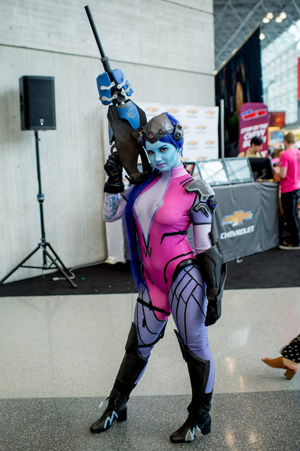 A fan cosplays as Widowmaker from Overwatch during the 2017 New York Comic Con, Day 4 on October 8, 2017 in New York City. (Photo by Roy Rochlin/WireImage)