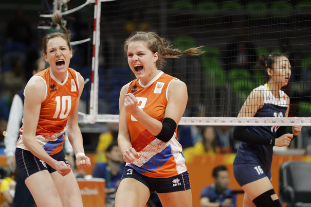 Netherlands' Lonneke Sloetjes (10) and Yvon Belien (3) react during a women's preliminary volleyball match against China at the 2016 Summer Olympics in Rio de Janeiro, Brazil, Saturday, August 6, 2016. (Photo by Matt Rourke/AP Photo)