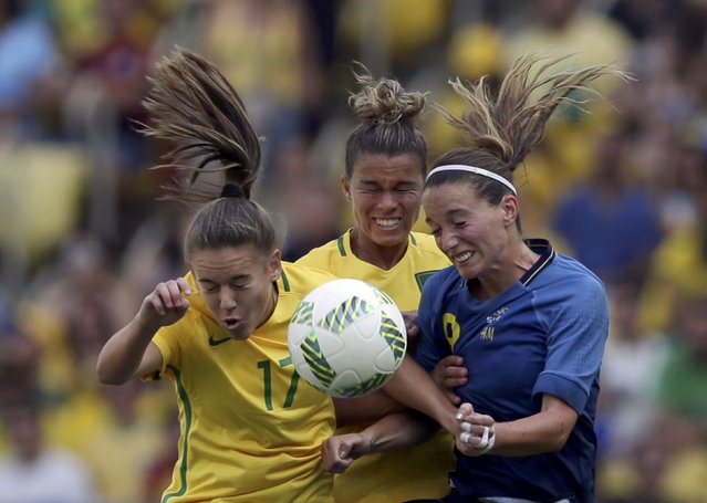 2016 Rio Olympics, Soccer, Semifinal, Women's Football Tournament Semifinal Brazil vs Sweden, Maracana, Rio de Janeiro, Brazil on August 16, 2016. Andressa (BRA) of Brazil (L), Tamires (BRA) of Brazil and Kosovare Asllani (SWE) of Sweden compete. (Photo by Bruno Kelly/Reuters)