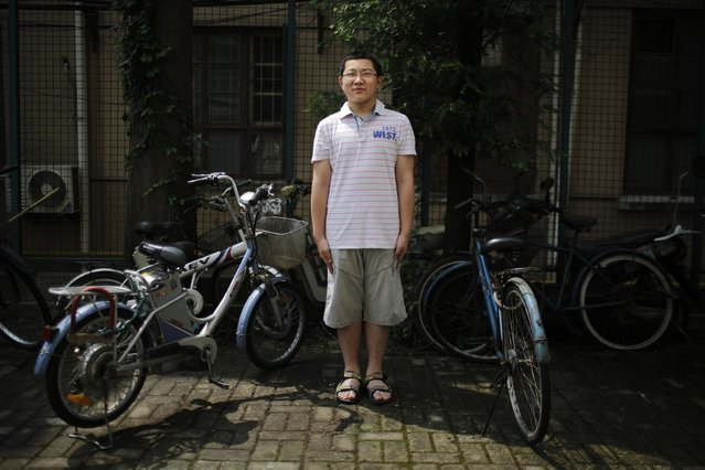 "Ding Tieru, who was born in 2002, poses for a photograph in Shanghai July 27, 2014. ""I have a cousin. I'd like to have a brother. Because we would be able to play together. I want more friends. We would be able to help each other in our studies"", said Tieru. (Photo by Carlos Barria/Reuters)"