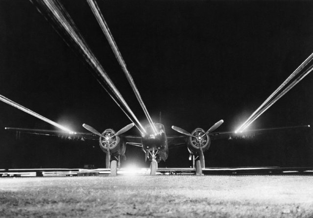 A U.S. Air Force B-26 light bomber has its 14 forward firing .50 caliber machine guns tested at an airfield in Korea prior to a night mission against communist targets on October 24, 1952. (Photo by AP Photo)