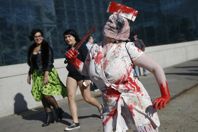 "Ashlee Mantione, dressed as the ""Dark Nurse"" from the ""Silent Hill 2"" video game, poses for a photograph at New York's Comic-Con convention, October 9, 2014. (Photo by Shannon Stapleton/Reuters)"
