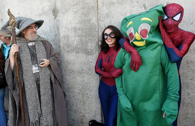 Costumed participants (L-R) Tim Fisher of Nyack, New York, Brianna Acevedo, Lucas Stellino and Julian Barillas, all of Queens New York, pose while arriving for the 2014 New York Comic Con in New York, New York, USA, 09 October 2014. The annual event offers pop culture fans exhibitors and displays of popular video games, movies and comic books and many people attending dress as their favorite character. (Photo by Justin Lane/EPA)