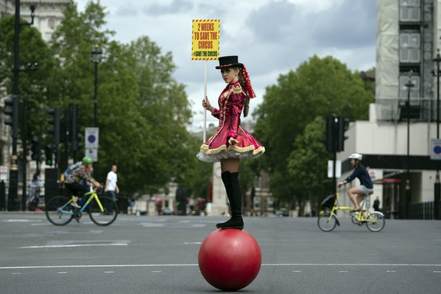 Circus performer from the Association of Circus Proprietors on Whitehall, London, Britain, 07 July 2020. The association handed a petition to Downing Street to ask British Prime Minister Boris Johnson to allow circuses to reopen. (Photo by Will Oliver/EPA/EFE)
