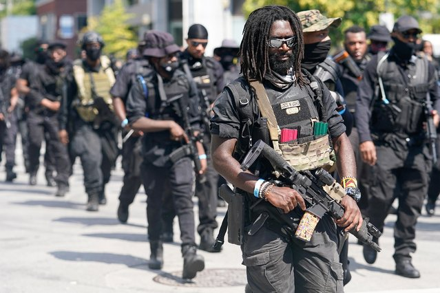 Members of an all-Black militia group called NFAC hold an armed rally in Louisville, Kentucky, U.S. July 25, 2020. A group of heavily armed Black protesters marched through Louisville, Kentucky demanding justice for Breonna Taylor, a Black woman killed in March by police officers who burst into her apartment. (Photo by Bryan Woolston/Reuters)