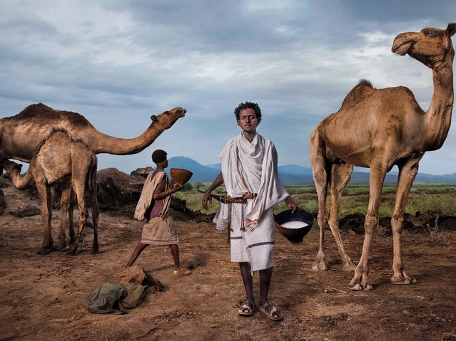 """""""The Chieftain"""". Roba Bulga Jilo, an Ethiopian food activist, he is a member of the Karrayyu tribe of nomadic herders, with whom he has established a Slow Food Presidium to safeguard camel milk, a product with a symbolic value in Ethiopia. (Photo by Steve McCurry/2015 Lavazza Calendar)"""