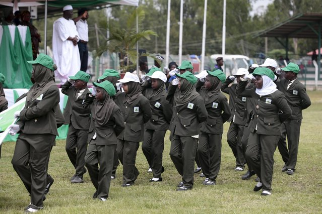 Students of Al Rahman Int. school salute as they march in a parade at the Old Parade ground during celebrations to commemorate Nigeria's 55th Independence Day in Abuja, Nigeria, October 1, 2015. (Photo by Afolabi Sotunde/Reuters)