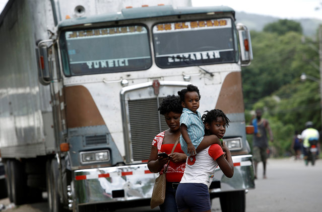 An African migrant stranded in Costa Rica carries on his shoulders a child on the Inter-American Highway at the border between Costa Rica and Nicaragua, in Penas Blancas, Costa Rica, September 7, 2016. (Photo by Juan Carlos Ulate/Reuters)