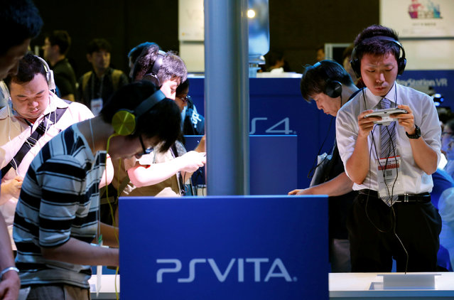 People play with Sony's PlayStation Vita at Tokyo Game Show 2016 in Chiba, east of Tokyo, Japan, September 15, 2016. (Photo by Kim Kyung-Hoon/Reuters)