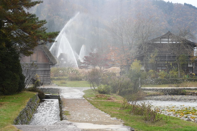Water is seen discharged over the traditional farm houses at Shirakawa-go, the UNESCO World Heritage site on November 9, 2014 in Shirakawa, Japan. (Photo by Kaz Photography/Getty Images)