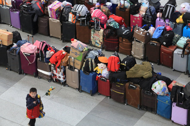 Bags and suitcases are seen at Shenyang North railway station as people travel ahead of the Chinese Lunar New Year, or the Spring festival, in Liaoning province, China on February 1, 2018. (Photo by Reuters/China Stringer Network)