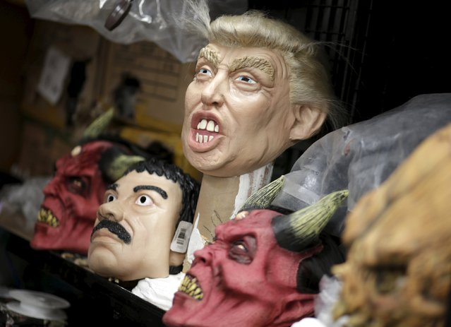 "Masks of Republican presidential candidate Donald Trump (C) and Joaquin ""El Chapo"" Guzman (2nd L) are seen at Grupo Rev in the Mexican city of Cuernavaca near Mexico City, October 14, 2015. (Photo by Henry Romero/Reuters)"