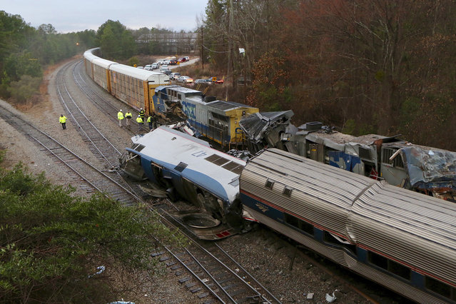 Authorities investigate the scene of a fatal Amtrak train crash in Cayce, South Carolina, Sunday, February 4, 2018. At least two were killed and dozens injured. (Photo by Tim Dominick/The State via AP Photo)