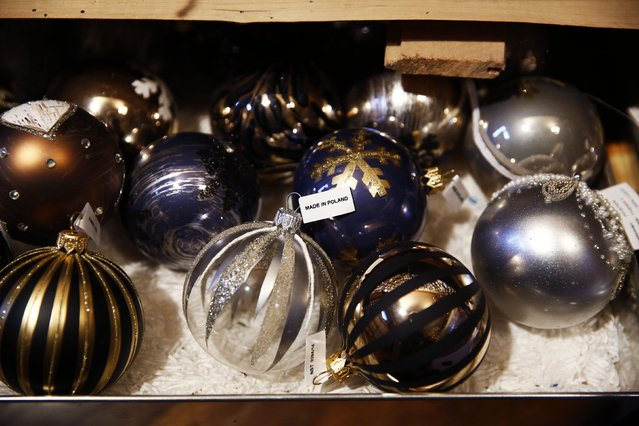 Glass baubles are displayed at the Silverado manufacture of hand-blown Christmas ornaments in the town of Jozefow outside Warsaw December 2, 2014. (Photo by Kacper Pempel/Reuters)