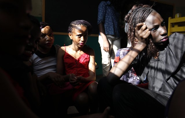 "Models are seen at a makeshift venue backstage before the Miss Koch beauty pageant, titled ""Getting to Zero Teenage Pregnancy"", at the Korogocho slums in Nairobi, December 6, 2014. (Photo by Thomas Mukoya/Reuters)"