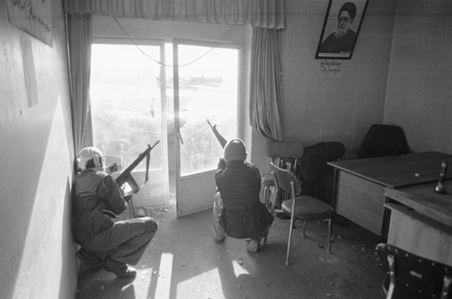 Armed members of the Republican Muslim People's Party, which supports Ayatollah Shariatmadari, on guard at party headquarters in Tabriz, Iran, December 29, 1979, following clashes with Revolutionary Guards of Ayatollah Khomeini. (Photo by Jacques Langevin/AP Photo)