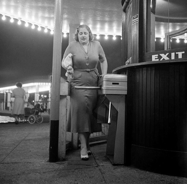 Dorothy Bradley, photographed for LIFE magazine article on obesity, squeezes through turnstile, 1949. (Photo by Martha Holmes/Time & Life Pictures)