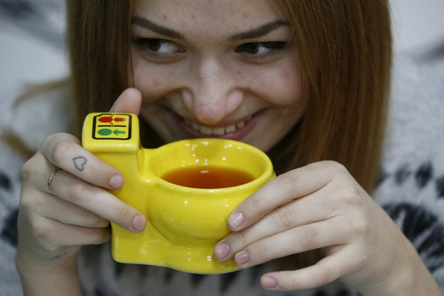 A woman drinks tea at Crazy Toilet Cafe in central Moscow, Russia October 30, 2015. (Photo by Sergei Karpukhin/Reuters)