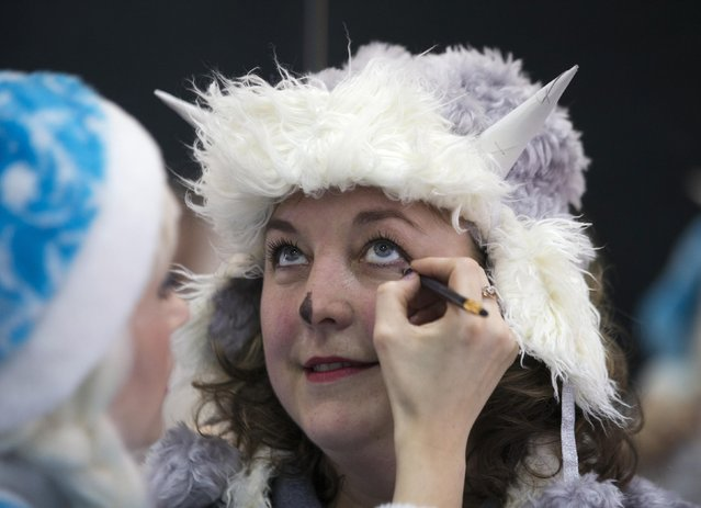"Women dressed as Snow Maiden prepare themselves for the contest ""Yolka-fest-2014"" (Fir-festival-2014) in Minsk December 12, 2014. (Photo by Vasily Fedosenko/Reuters)"