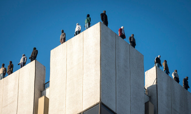 """An art installation called """"Project 84"""", which aims to raise awareness that 84 men take their own lives every week in the UK, has been unveiled in London, England on March 26, 2018. Twelve of the sculptures are positioned on the roof of ITV's This Morning studio in Waterloo; the remaining 72 are on the roof of the ITV studios tower. (Photo by Steve Meddle/ITV/Rex Features/Shutterstock)"""