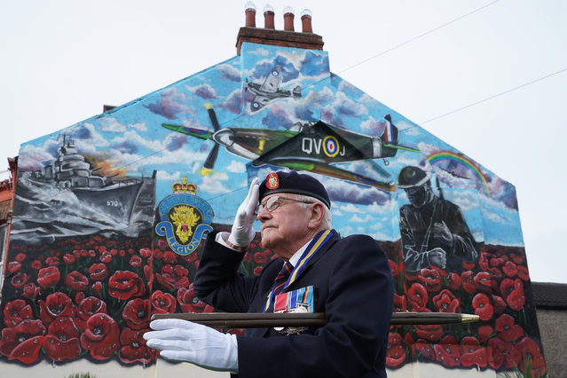 Eric Howden BEM, 76, chairman of the Redcar British Legion who served with the Royal Ordnance Corps, in front of a commemorative war mural in Redcar, North Yorkshire, ahead of a two minute silence to remember the war dead on Armistice Day on November 11, 2020. (Photo by Owen Humphreys/PA Images via Getty Images)