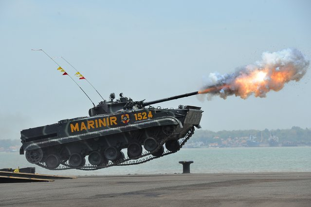 An Indonesian Marine tank jumps and launches missiles during The 69th Republic of Indonesian Military Anniversary on October 7, 2014 in Surabaya, Indonesia. (Photo by Robertus Pudyanto/Getty Images)