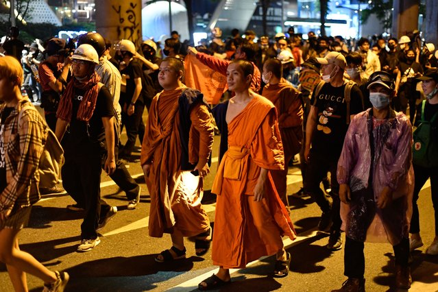 Buddhist monks attend an anti-government rally outside the Royal Thai Police Headquarters on November 18, 2020 in Bangkok, Thailand. (Photo by Vachira Vachira/NurPhoto via Getty Images)