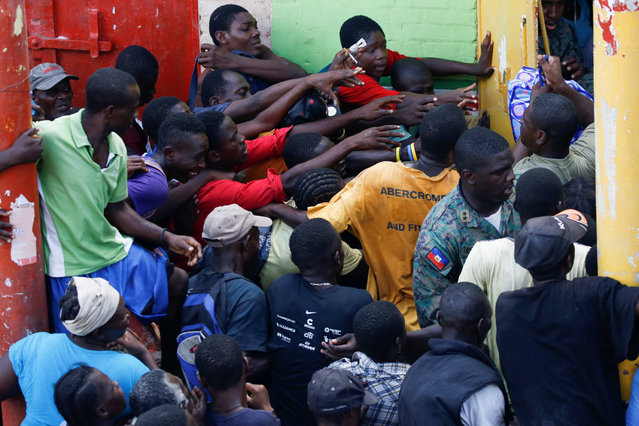 People wait for food to be handed out after Hurricane Matthew hit Jeremie, Haiti, October 18, 2016. (Photo by Carlos Garcia Rawlins/Reuters)