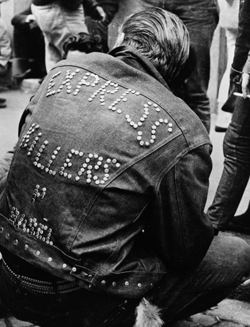 """A man wearing a studded denim jacket bearing the words """"Express Killers"""" attends a Teddy Boy convention in Zurich, 1962. (Photo by Keystone Features/Getty Images)"""
