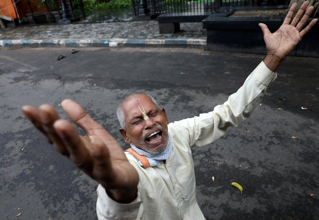 A Hindu devotee reacts after ISKCON (International Society of Krishna Consciousness) cancelled the annual Rath Yatra, or chariot procession, amidst the coronavirus disease (COVID-19) outbreak, in Kolkata, India, June 23, 2020. (Photo by Rupak De Chowdhuri/Reuters)