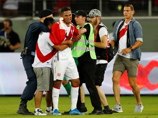 Peru fan invades the pitch and embraces Peru's Anderson Santamaria as security intervene during an international friendly football match Saudi Arabia vs Peru at Kybunpark stadium in St. Gallen, on June 3, 2018. (Photo by Stefan Wermuth/Reuters)