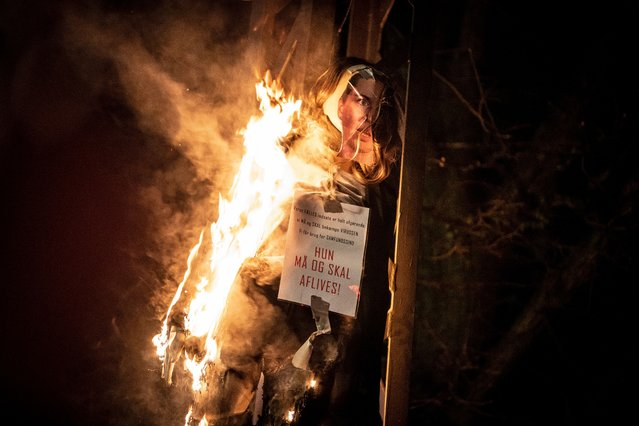 """An effigy representing Danish Prime Minister Mette Frederiksen with a sign around her neck reading 'She must be put down' is set alight by protesters during a demonstration organized by a group calling itself """"Men in Black"""", in Copenhagen, Denmark, 23 January 2021 (issued 24 January 2021). The burning of the effigy provoked indignation among several Danish politicians, local media reported. Protesters took to the streets of the Danish capital against pandemic restrictions as well as against coronavirus disease (COVID-19) vaccinations. (Photo by Mads Claus Rasmussen/EPA/EFE)"""
