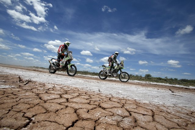 KTM rider Pierre Cherpin (L) of France and Kawasaki rider Guido Martinelli of Argentina ride during the 2nd stage of the Dakar Rally 2015, from Villa Carlos Paz to San Juan January 5, 2015. (Photo by Jean-Paul Pelissier/Reuters)