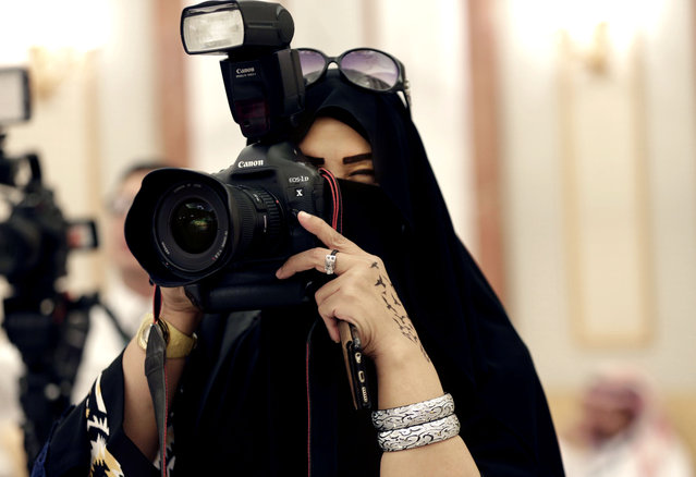 In this Tuesday, November 10, 2015 photo, a journalist takes photos at a palace in Riyadh, Saudi Arabia. Outside the Saudi capital of Riyadh, in one of the country's most conservative provinces, Jowhara al-Wably is making history by running as a female candidate in upcoming elections. Saturday's vote for municipal council seats marks two milestones for Saudi women: It is the first time women are allowed to vote in a government election and the first time women can run as candidates. (Photo by Hasan Jamali/AP Photo)