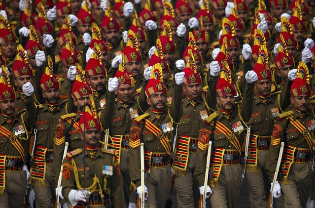 Indian soldiers march down Rajpath, a ceremonial boulevard, during full dress rehearsal ahead of the Republic Day parade in New Delhi, India, Friday, January 23, 2015. (Photo by Saurabh Das/AP Photo)