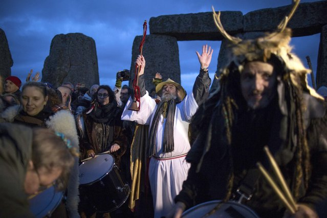 Revellers celebrate the winter solstice at Stonehenge on Salisbury Plain in southern England December 22, 2015. (Photo by Kieran Doherty/Reuters)