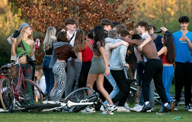 People gather on Lammas Land in Cambridge on Monday, March 29, 2021, on the first day of a major easing of England's coronavirus lockdown to allow far greater freedom outdoors. (Photo by PA Wire/PA Images via Getty Images)