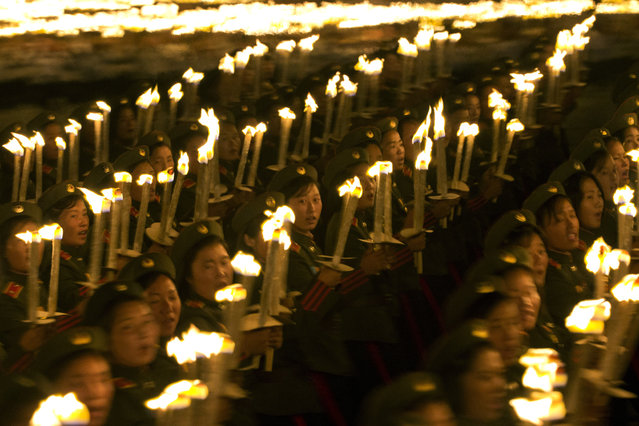 North Korean military cadets take part in a torch light march held in conjunction with the 70th anniversary of North Korea's founding day celebrations in Pyongyang, North Korea, Monday, September 10, 2018. (Photo by Ng Han Guan/AP Photo)