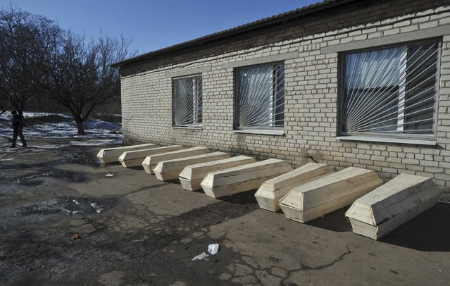 Coffins with bodies of killed Ukrainian soldiers are pictured outside a morgue in Artemivsk, February 18, 2015. (Photo by Oleksandr Klymenko/Reuters)